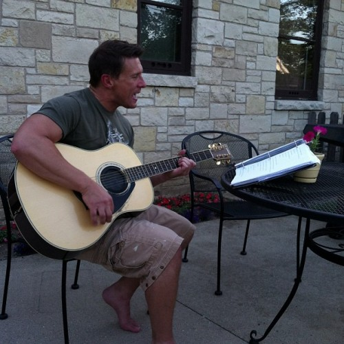 Beth's husband, Joe, playing his guitar